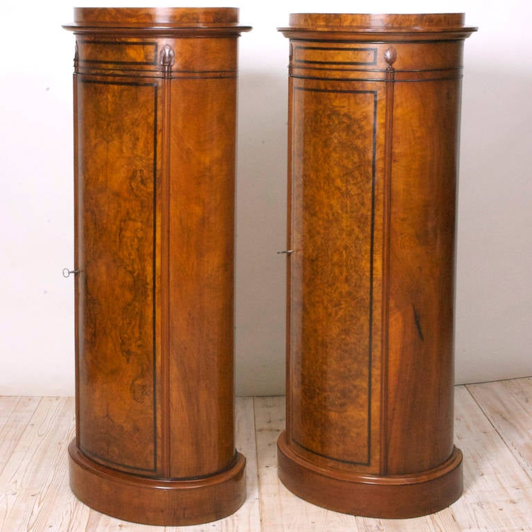 Near pair of beautifully crafted burled walnut cylinder cabinets from the reign of Christian VIII in Denmark. These cabinets are not an exact pair but work well together. One of the great utilitarian art objects of Danish design from the 19th