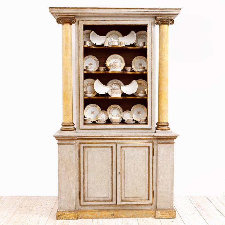 A very beautiful & tall Italian neoclassical cabinet with polychromed finish, with open display shelves over base with two doors. This impressive cabinet is very dramatic with its faux marbleized, robust columns & ionic capitals. Italy, late