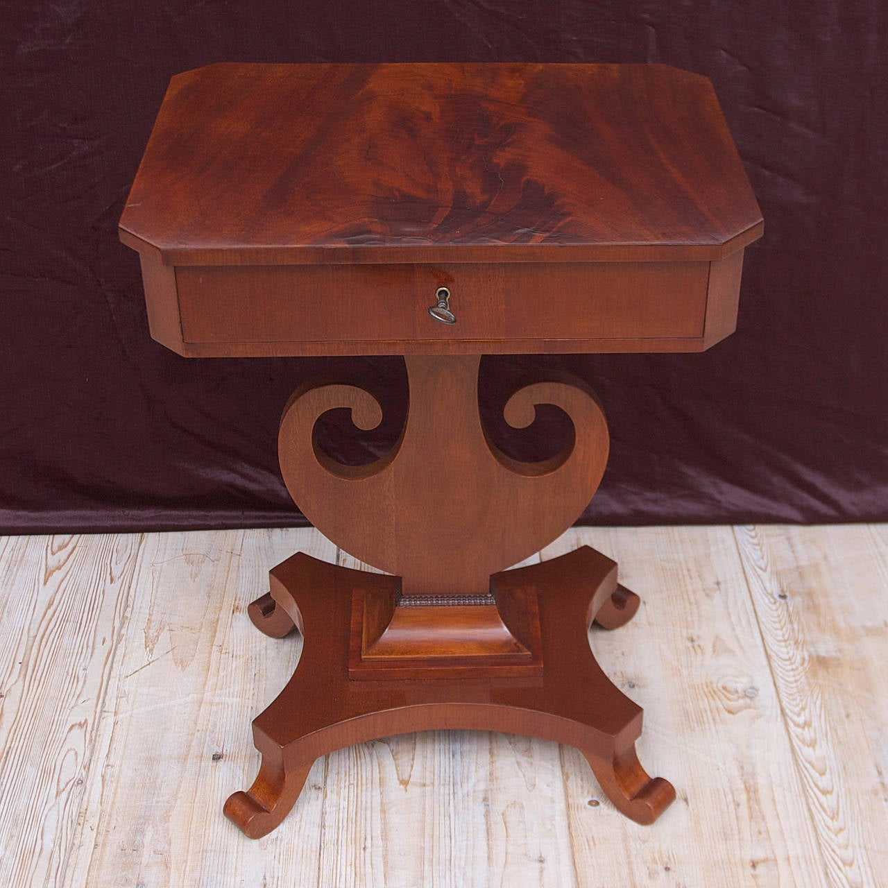 This Biedermeier side table in mahogany with lyre pedestal on quatre form base, with scroll feet is a unique Scandinavian form from the reign of Karl Johan of Sweden, circa 1845. Dimensions: 21 1/2