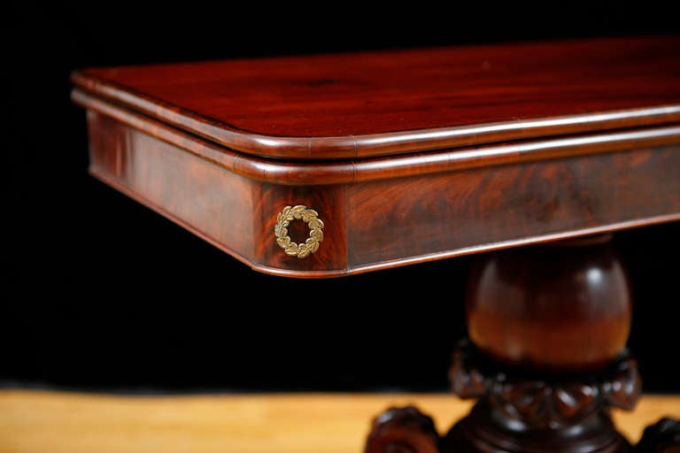 A fine Boston Federal game table in mahogany with fire gilded bronze doré ormolu mounts in the corners of the apron and original brass paw foot casters. Carving is well articulated and form is reminiscent of Federal Boston cabinet maker Isaac Vose.