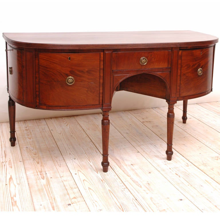 An English George III sideboard just over 5' long in mahogany in