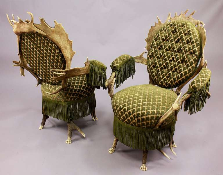 A pair of very rare antler armchairs made of stag antlers and fallow deer antlers, with feet carved as lions claws, Austria, circa 1880.