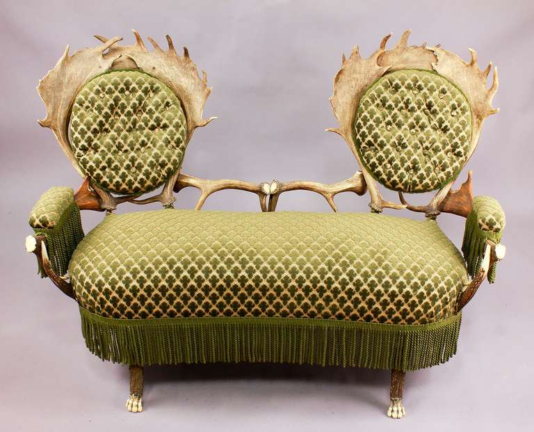 An unusual antler settee made of stag antlers and fallow deer antlers, with feet carved as lions claws, Austria, circa 1880.