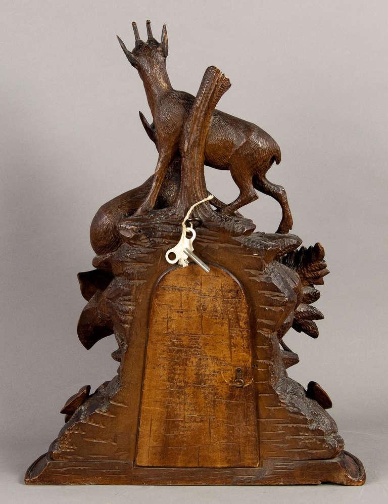 black forest carved wood chamois mantel clock at 1stdibs. Black Bedroom Furniture Sets. Home Design Ideas