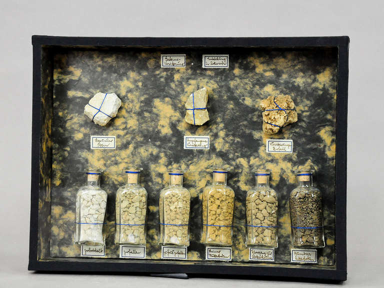 A vintage natural scientific specimen diorama shows the decomposition of rocks, used for class, circa 1900.
