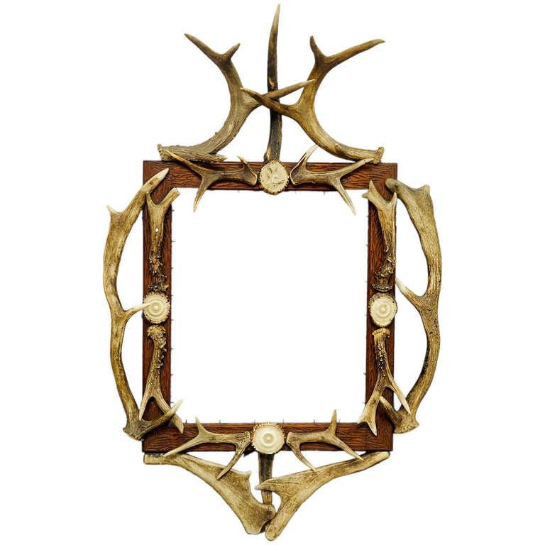 Black Forest Carved Frame With Antler Decoration At 1stdibs
