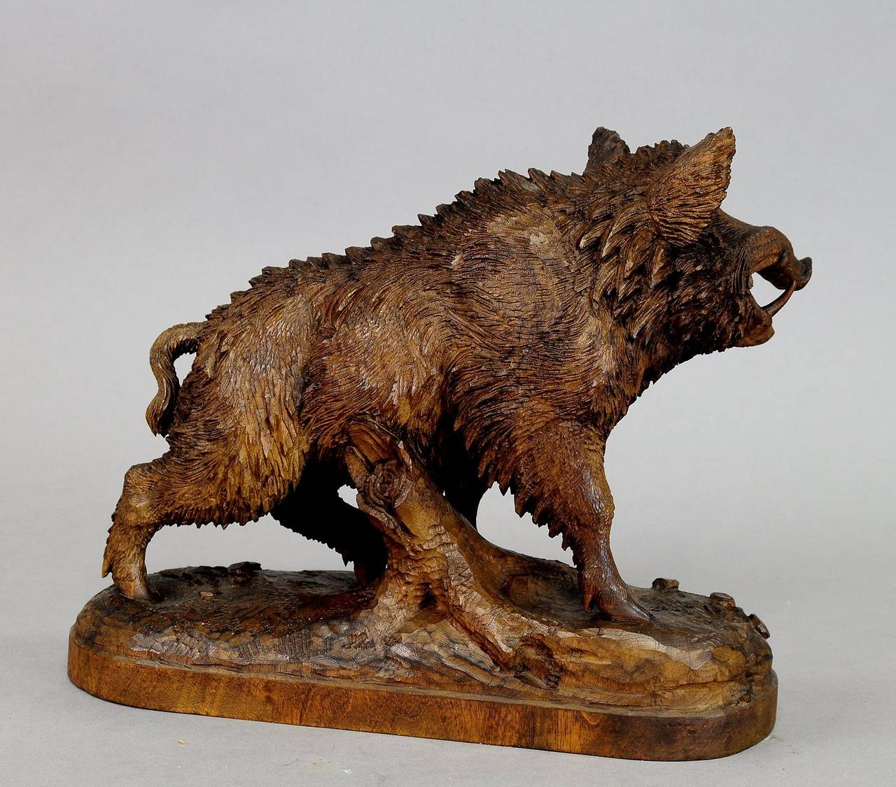 Great black forest carved wood wild boar in the manner