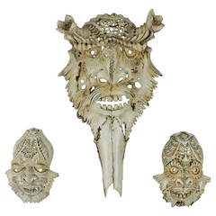 a set of three impressive carved deer skulls