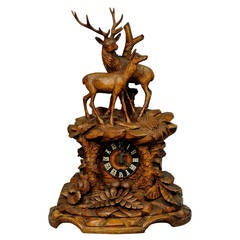 black forest carved wood mantelpiece clock with stag and doe
