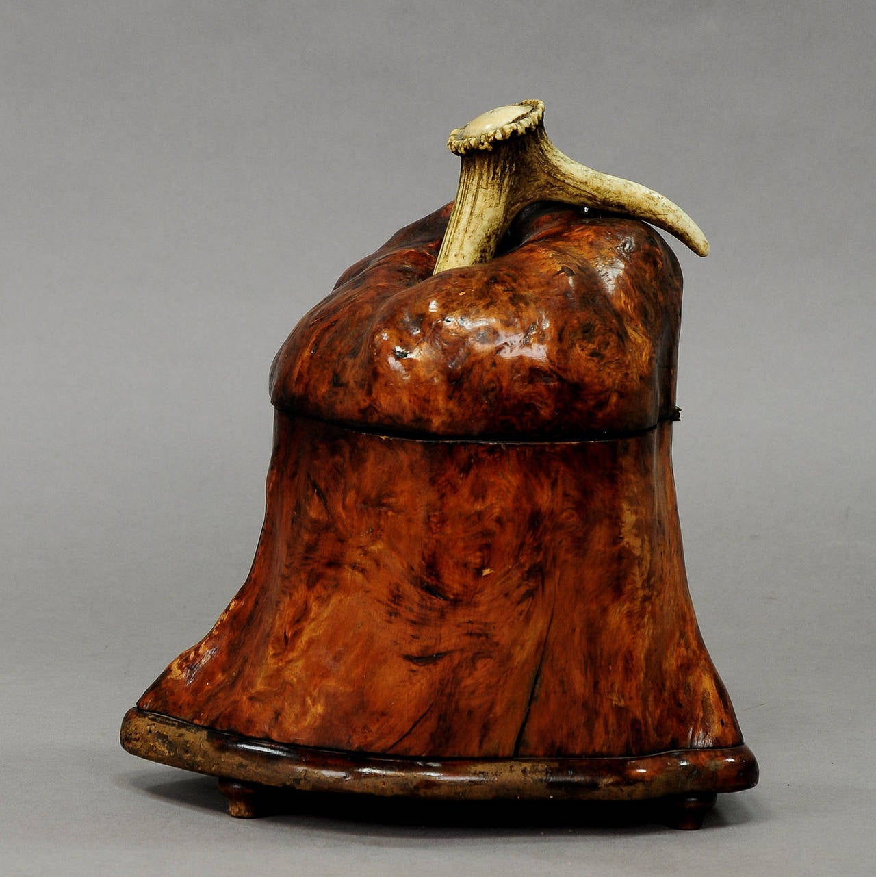 A rare tobacco jar made of a root wood with tin inset and with antler handle, Germany, circa 1910.