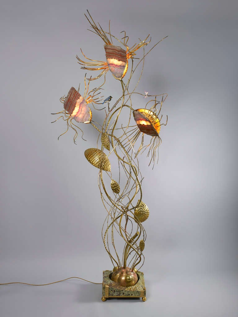 Taher Chemirik's first floor light sculpture, 'Carnivore', combines sculpted brass and a rhyolite foot with three large flowers or mouths made of rare Saxe Agates, lit from the inside. A very poetic piece and a narrative in itself, 'Carnivore'