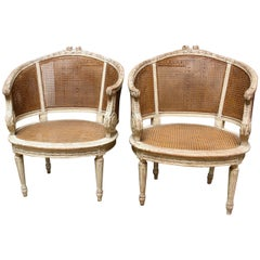 Pair of French Louis XVI Style Caned Bergeres in a Painted Finish