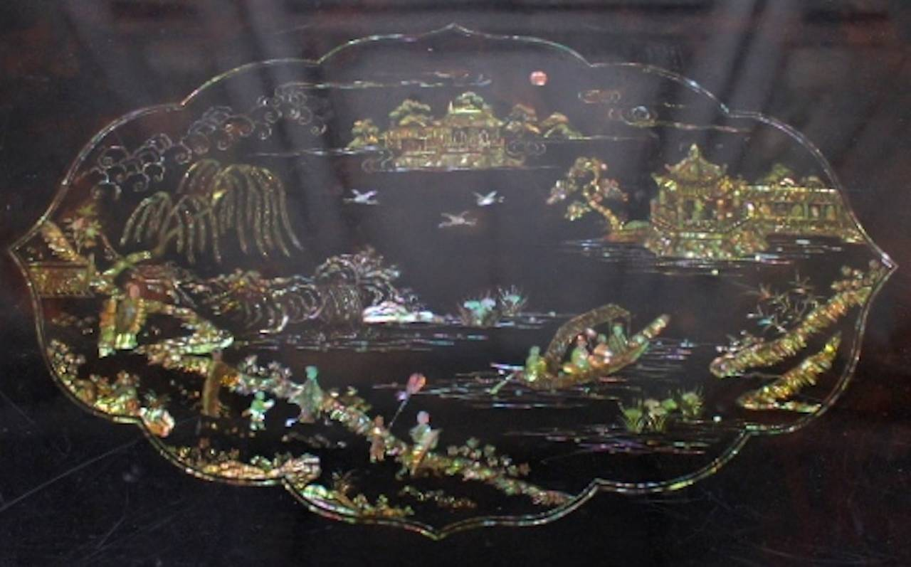 Carved Chinese Black Lacquer Coffee Table with Mother of Pearl Inlay For Sale