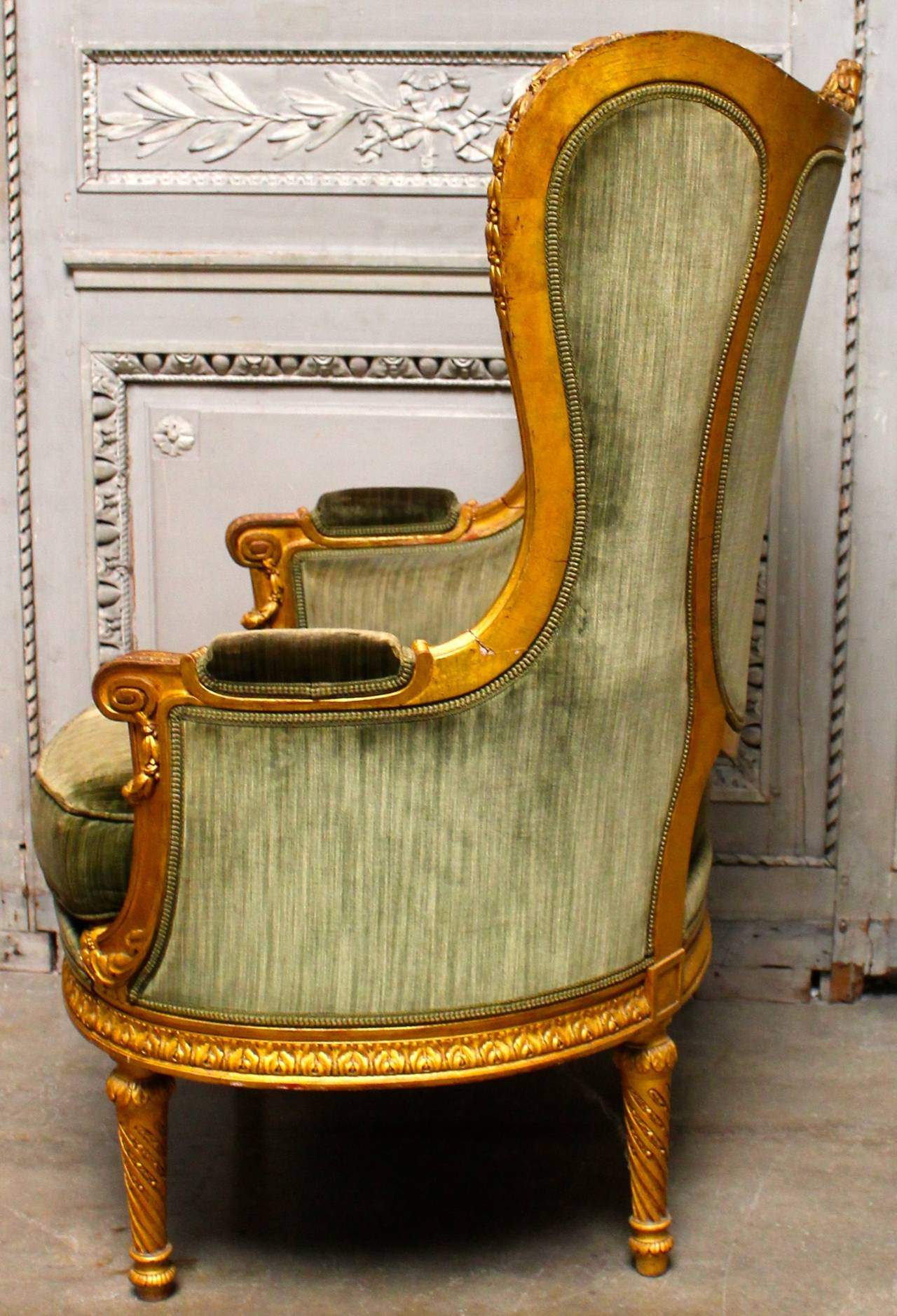 A French Louis XVI style beautifully carved giltwood bergere.