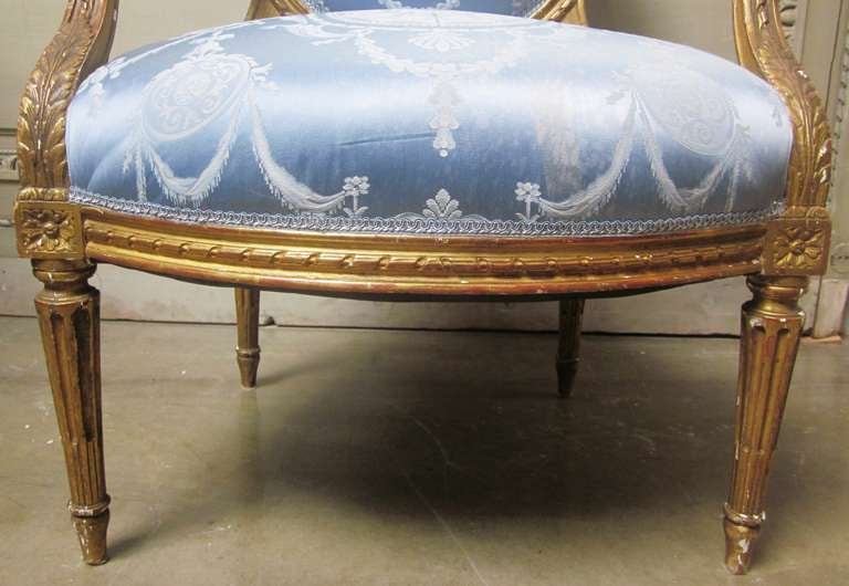 19th Century Pair of French Louis XVI Style Armchairs with a Gold Leaf Finish For Sale 2