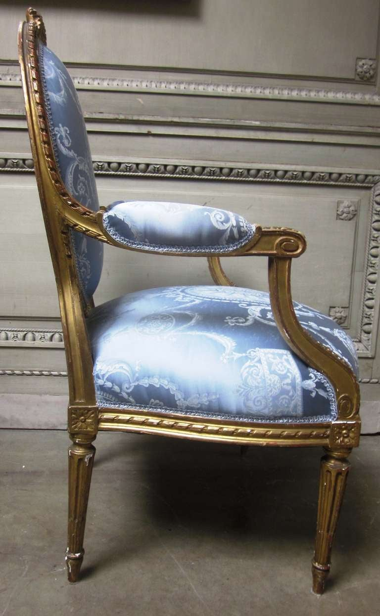 19th Century Pair of French Louis XVI Style Armchairs with a Gold Leaf Finish In Good Condition For Sale In Dallas, TX