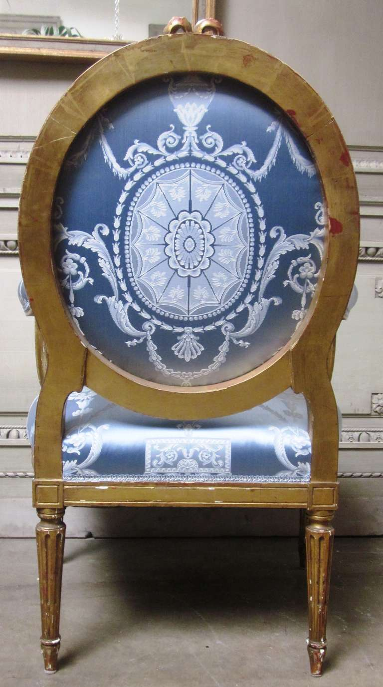 Wood 19th Century Pair of French Louis XVI Style Armchairs with a Gold Leaf Finish For Sale