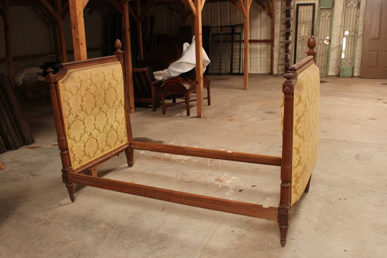 A French Louis XVI style carved walnut daybed.