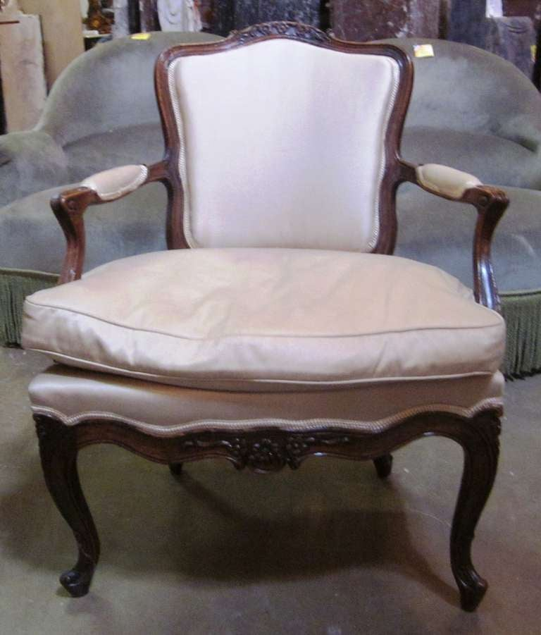 A set of four 18th century carved walnut Italian Rococo armchairs.