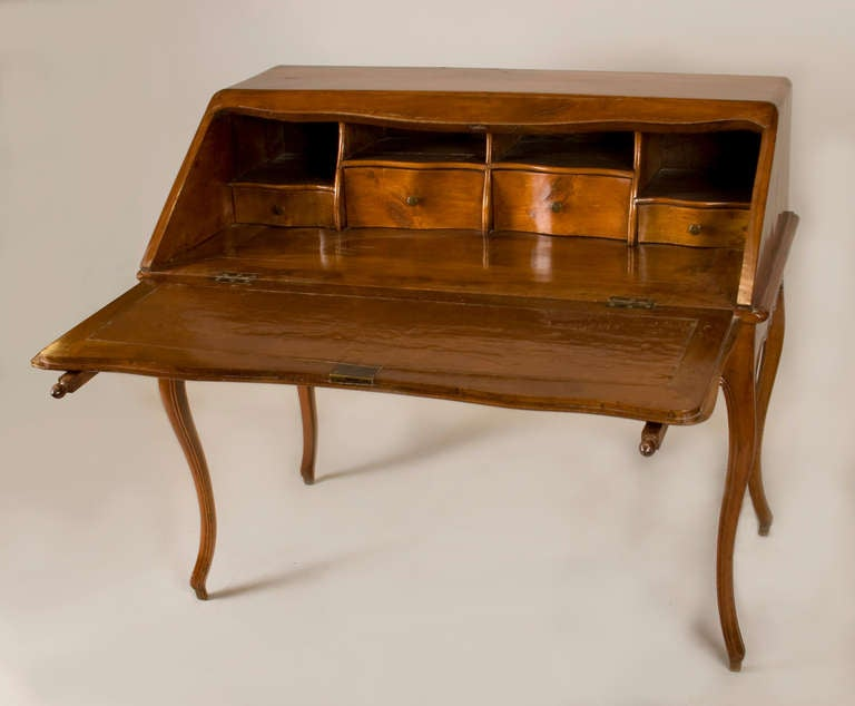 Louis XV fruitwood Bureau en Pente. Pull-out supports hold the fall front lid, opening to reveal drawers and compartments. The desk has a beautiful deep patina, never refinished. For it's age, the condition is superb. This is a rather large and