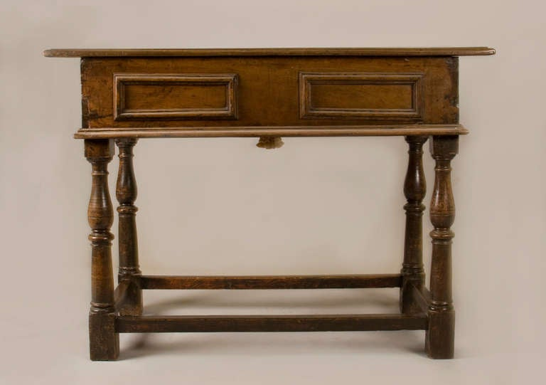 Italian baroque single drawer table with turned legs, all in walnut.