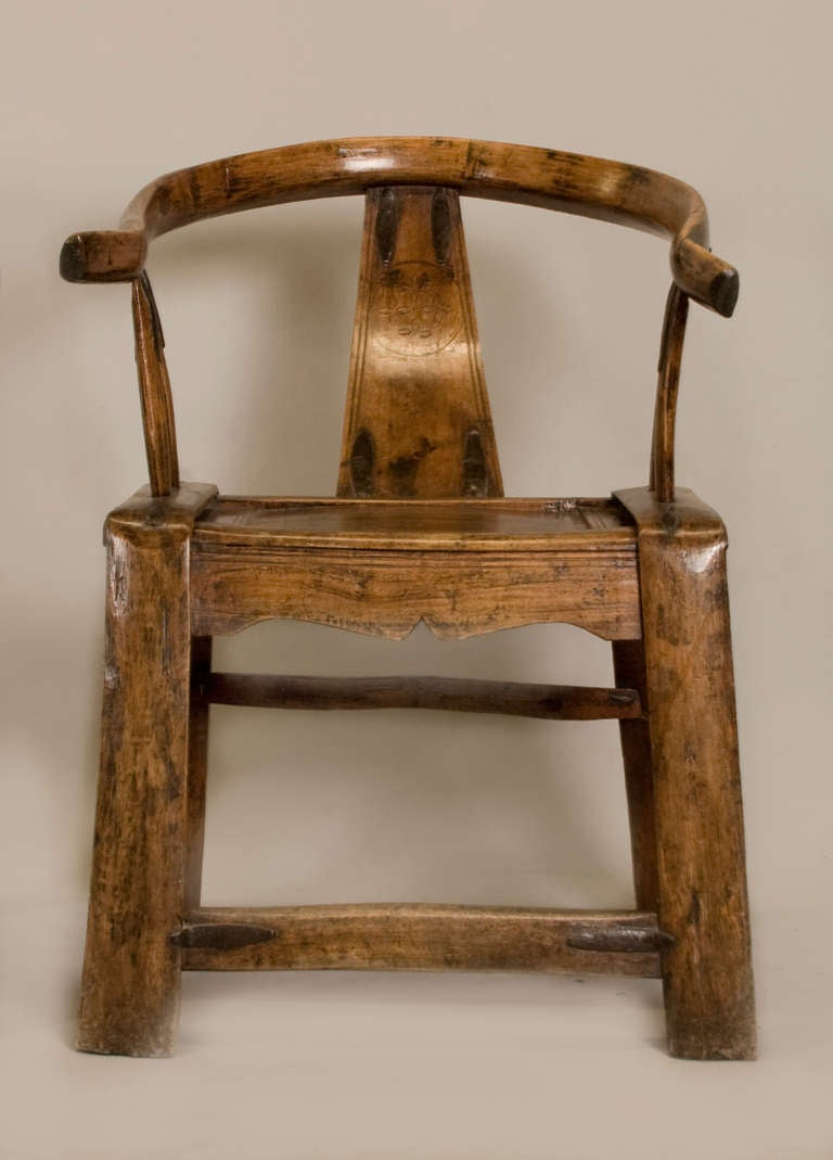 Pair of Chinese yoke back or scholar chairs made in Chinese elmwood.