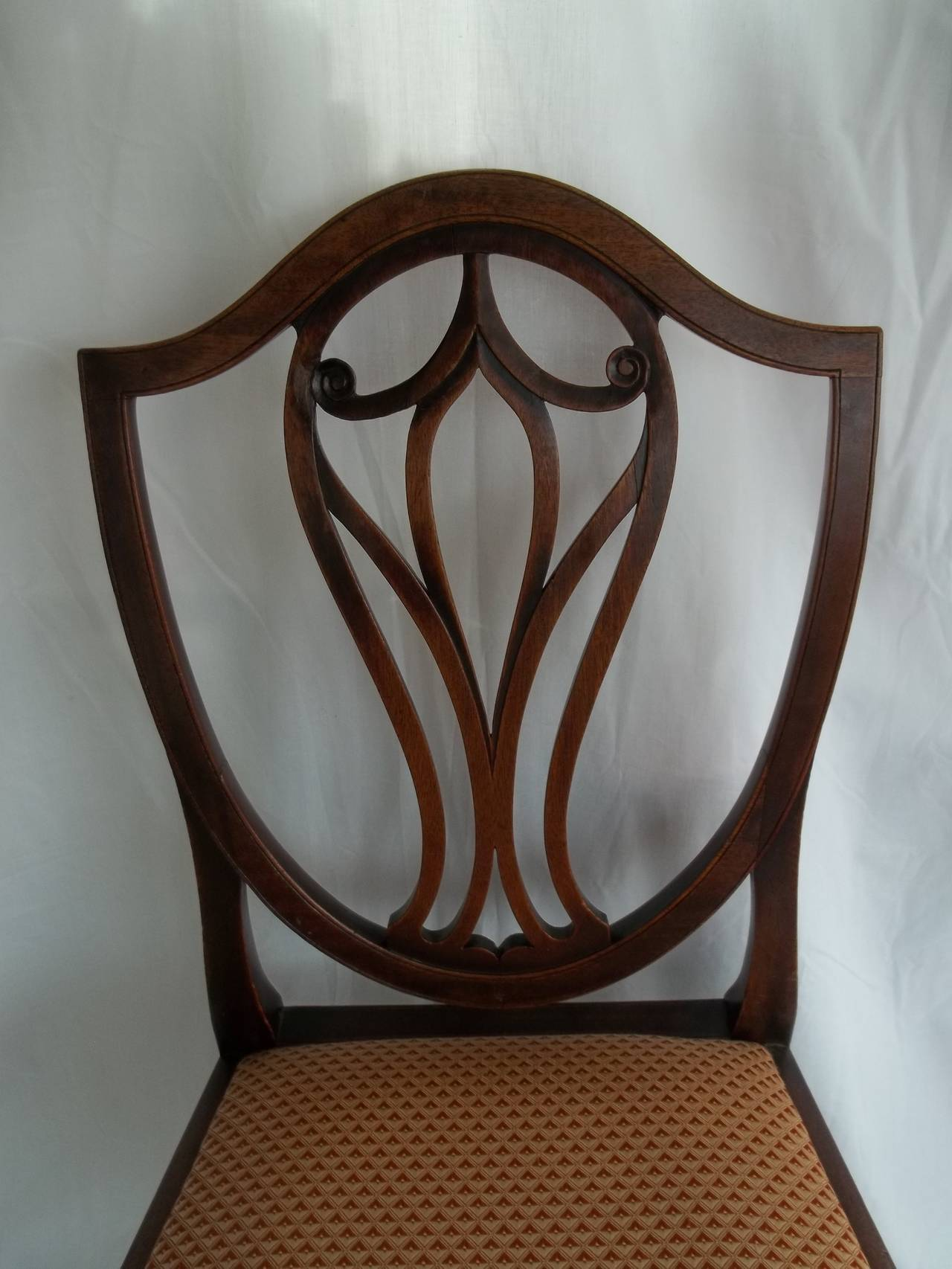 This is a very elegant, fine quality Side Chair from the late 18th Century, circa 1785.   Shield Back chairs of this date are popularly called Hepplewhite because very many chair makers followed the designs of George Hepplewhite, as illustrated in