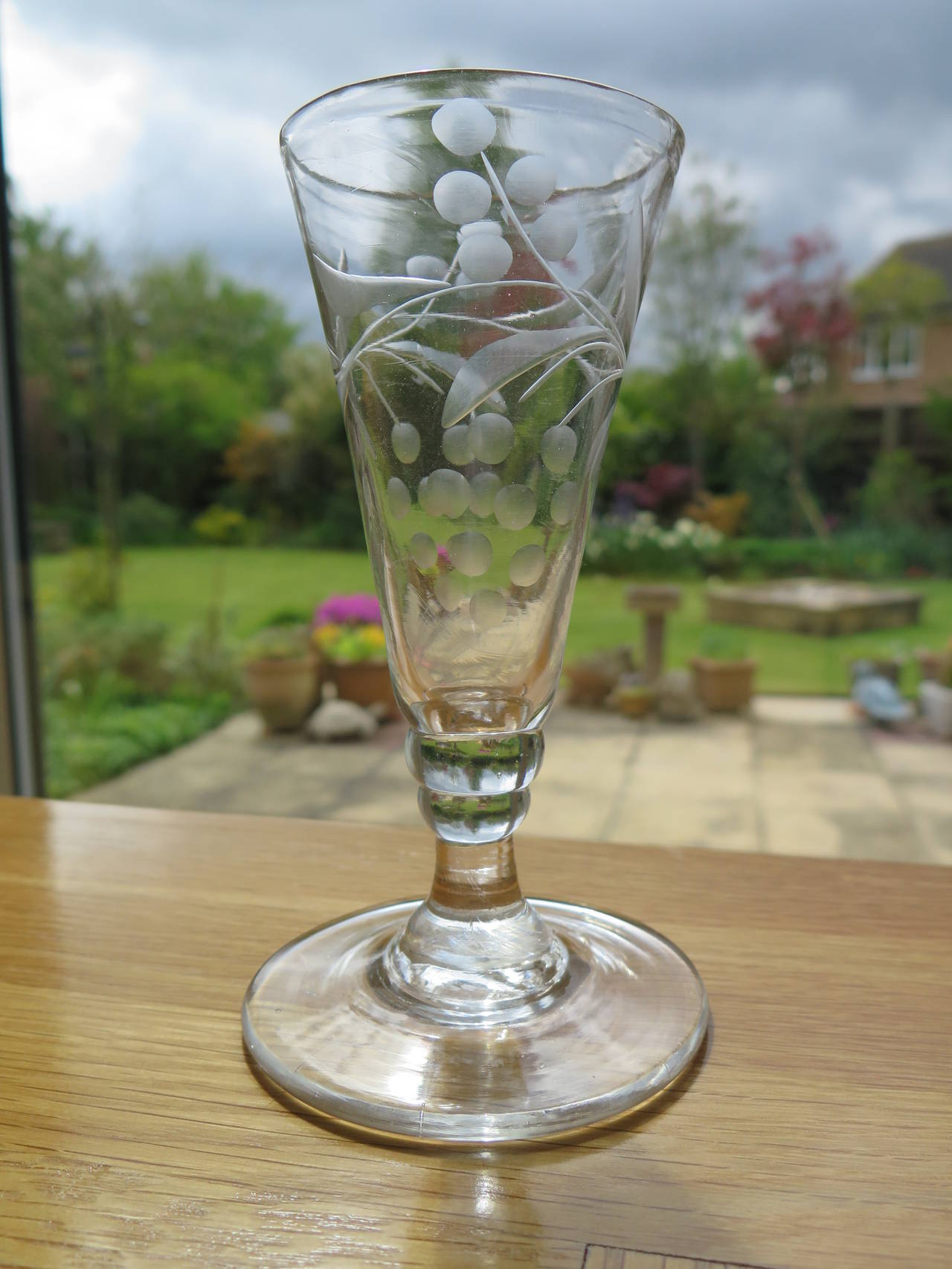 These are a good pair of English, Georgian drinking glasses, sometimes called Dwarf Ale glasses, from the late 18th century.   These glasses are individually handblown, from lead glass and as such are never identical and have slight differences in