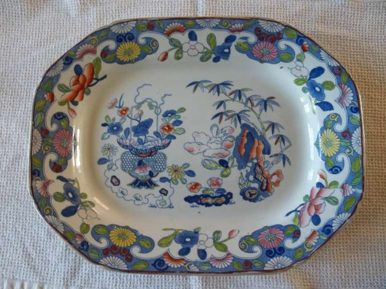 Very early 19th century Mason's Ironstone platters are rare and this is a fine heavy example.  This meat platter is beautifully hand decorated in the Imari style with the Bamboo pattern with much hand enameling in typical bold enamels, over a well