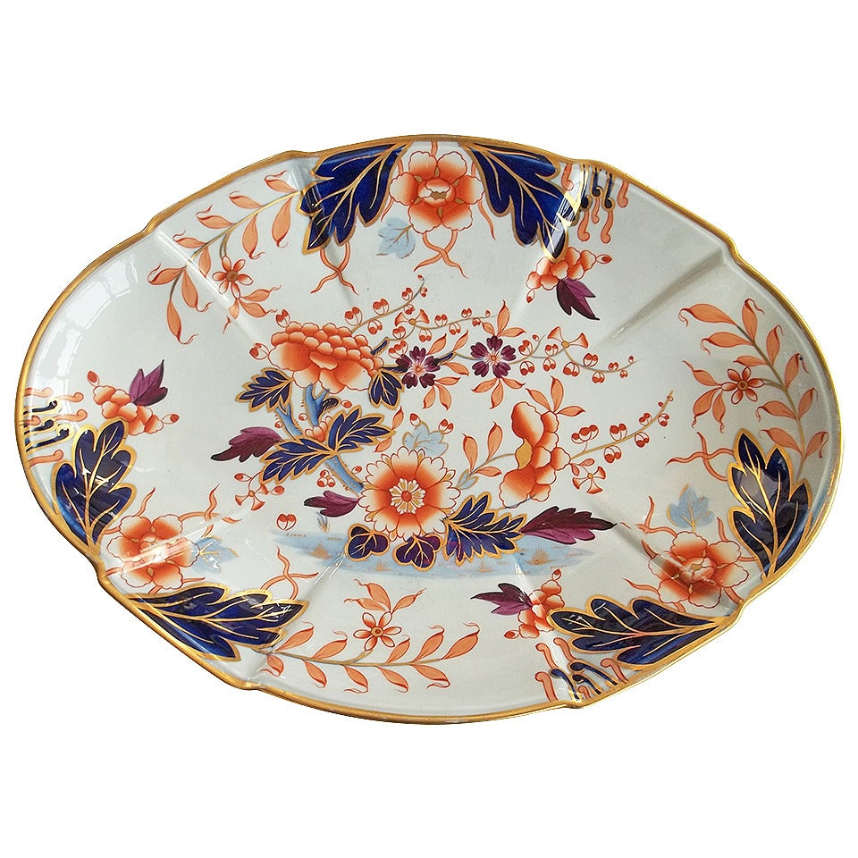 This is an excellent desert dish or platter made by William Davenport and Co., Longport, Staffordshire Potteries, England, circa 1810.  The dish is beautifully hand-painted in a bold Imari, Japan pattern No. 37 with rich gilded rim and detailed