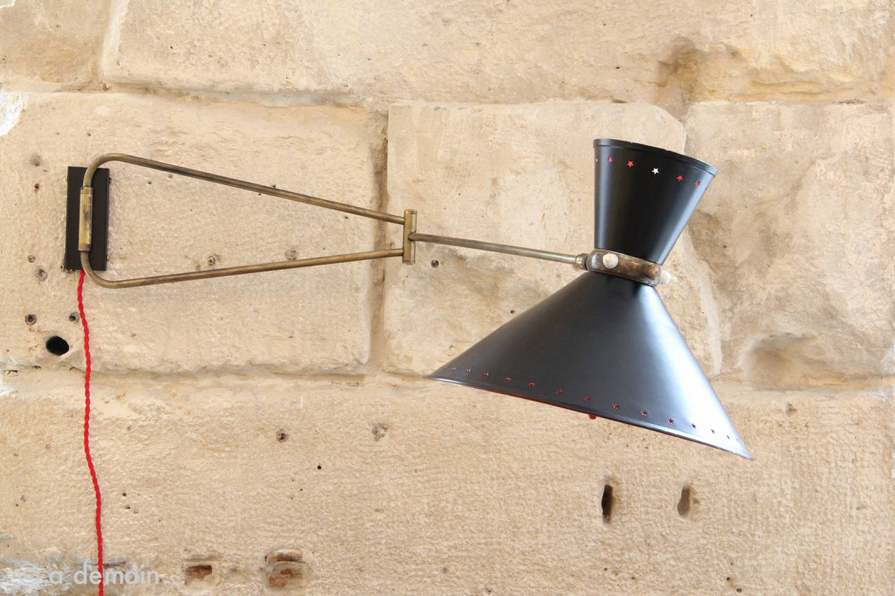 A Lunel sconce or wall lamp with the lampshade shaped as