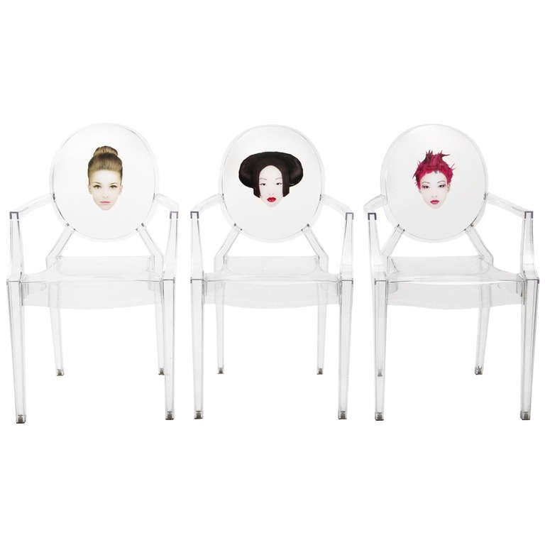 Three Louis Ghost chairs designed by Starck edited by
