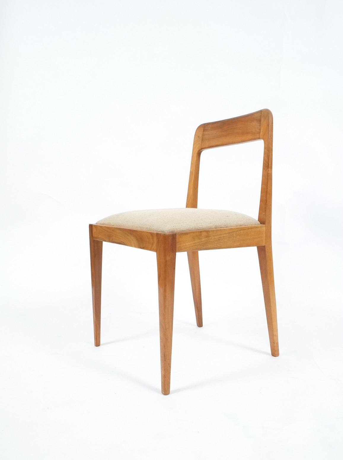 Rare set of six wooden chairs designed and executed by Carl Auböck and Robert Nestler in the 1950s (Model No. A 7) made from wood with upholstery made of beige fabric. The condition is very good. Upholstery might be customized.