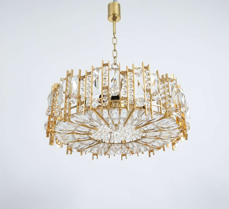 Beautiful Austrian Lobmeyr chandelier from the 1960s. This fixture was handcrafted and consists of alternating rows of different crystals varying in size and style. The condition is excellent, restored and rewired. The fixture holds nine bulbs in