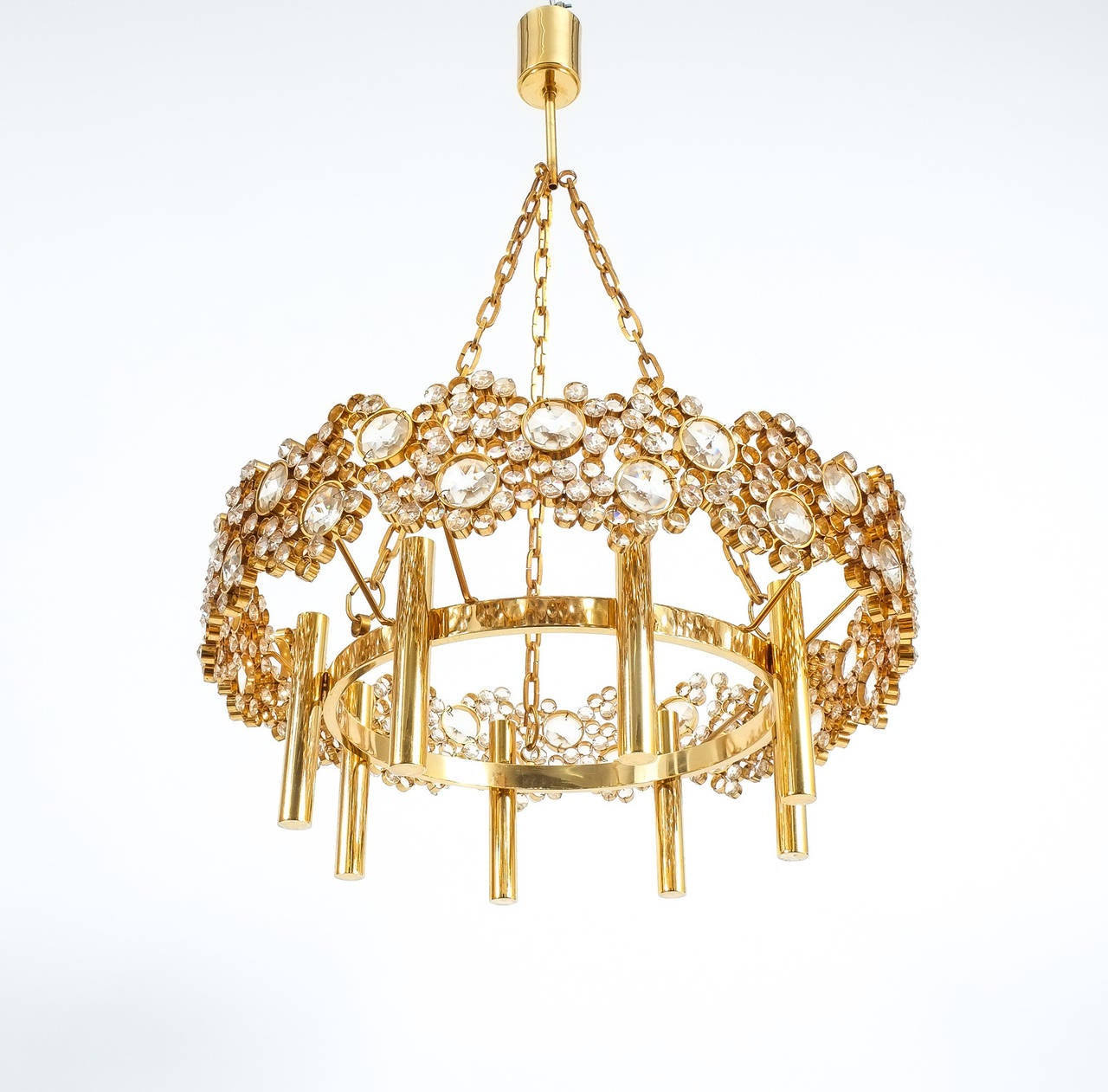 Beautiful 21 inch Corona chandelier from the 1960's by Palwa. Handcrafted and executed with great attention to detail this chandelier consists of hundreds of gilded brass rings encrusted with crystal glass varying in size. The light takes 8 bulbs