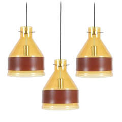 Set of Three J.T. Kalmar Yellow Glass Pendant Lamps with Leather Belts