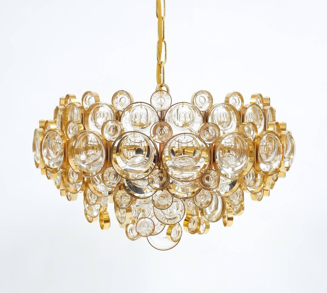 "Stunning 19.7"" (diameter) gold-plated chandelier by Palwa. With a taste for excellence in both craftsmanship and style this piece features different sized jewel like smooth optical crystals and gilded brass rings. It holds five large bulbs (E27"
