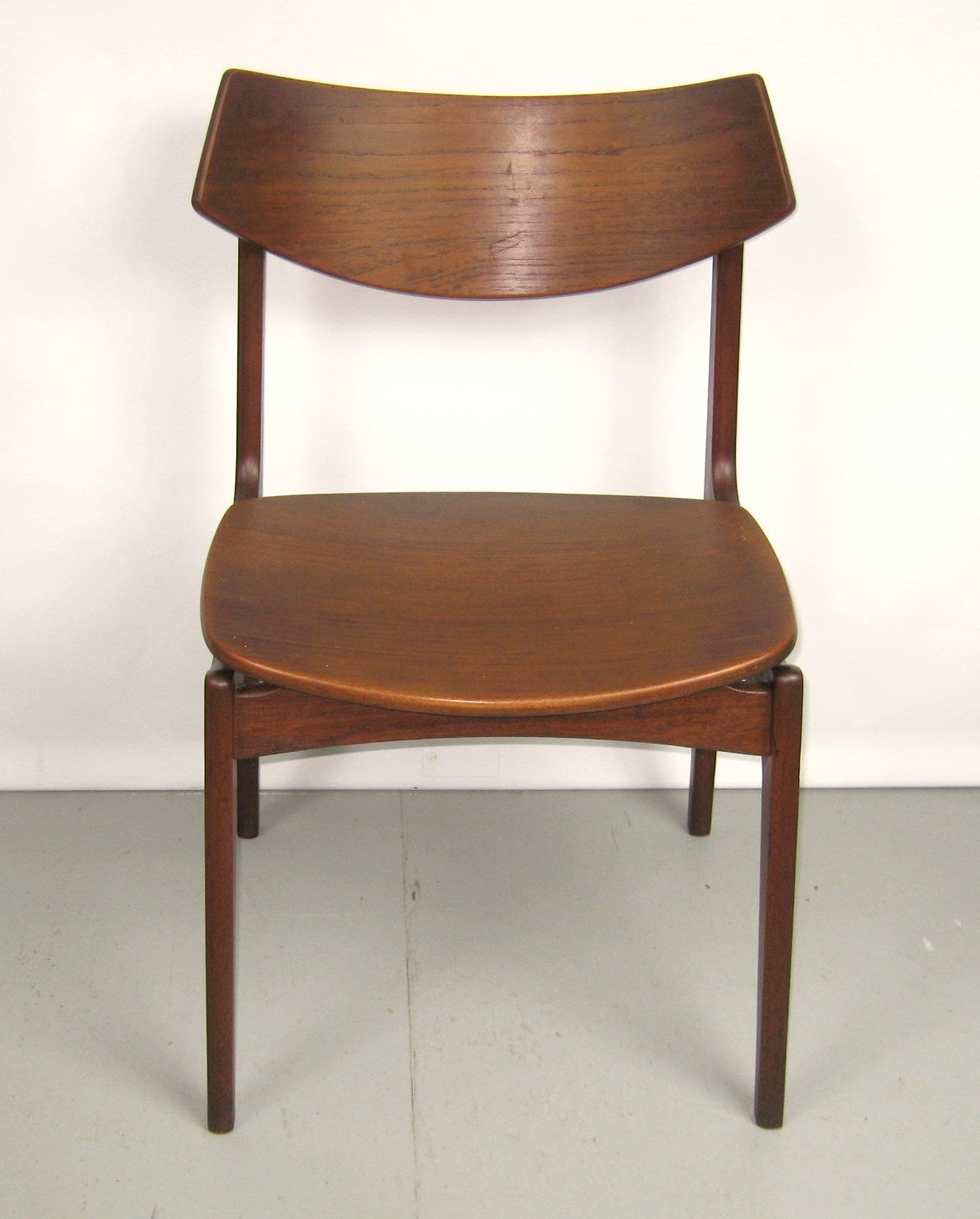 this teak danish modern dining room table with ten chairs by erik buck