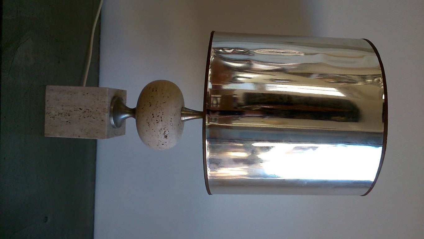 A minimalist travertine lamp by Philippe Barbier.  Base is 3.9 by 3.9 inches.  European socket and wiring.  Shade sold separately. Item currently located in France, please contact us for shipping options