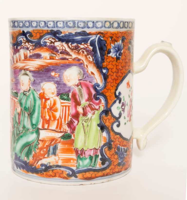 Chinese export porcelain mug, with decoration in the Mandarin Palate and a shaped handle. China, circa 1775.