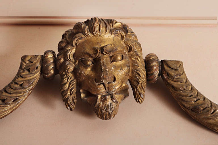 Very unique pair of  18th Century English wood and gilt curtain rods or over door decorative pieces with lions head in the center of each rod ending with a swan head on the ends.  These drapery rods are very well made in a curving pattern and the