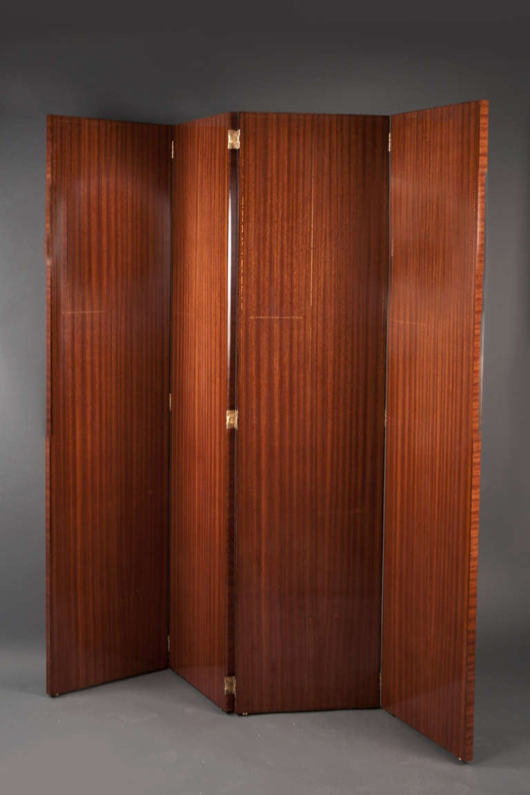 Mahogany veneer, lined throughout with Sornay's patented nailhead motif, mounted with brass hinges.