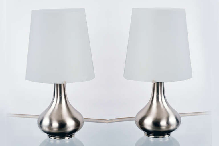 Brushed nickel table lamps with white satin glass shades. Fontana Arte model number 2344. Literature: Pierre-Emmanuel Martin-Vivier's Max Ingrand: Du verre à la lumière, Norma Editions, model pictured on page 192.