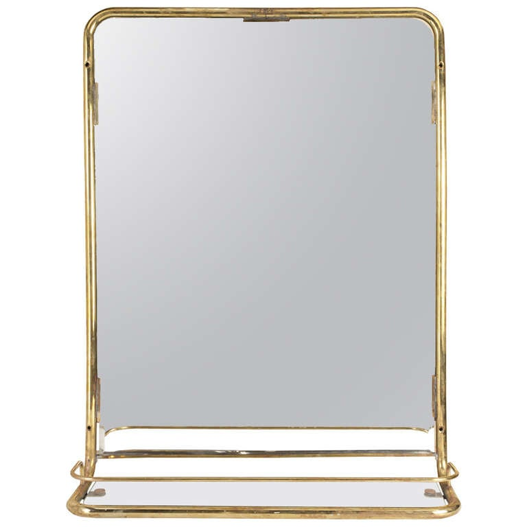Mid century ship s stateroom brass mirror with shelf at