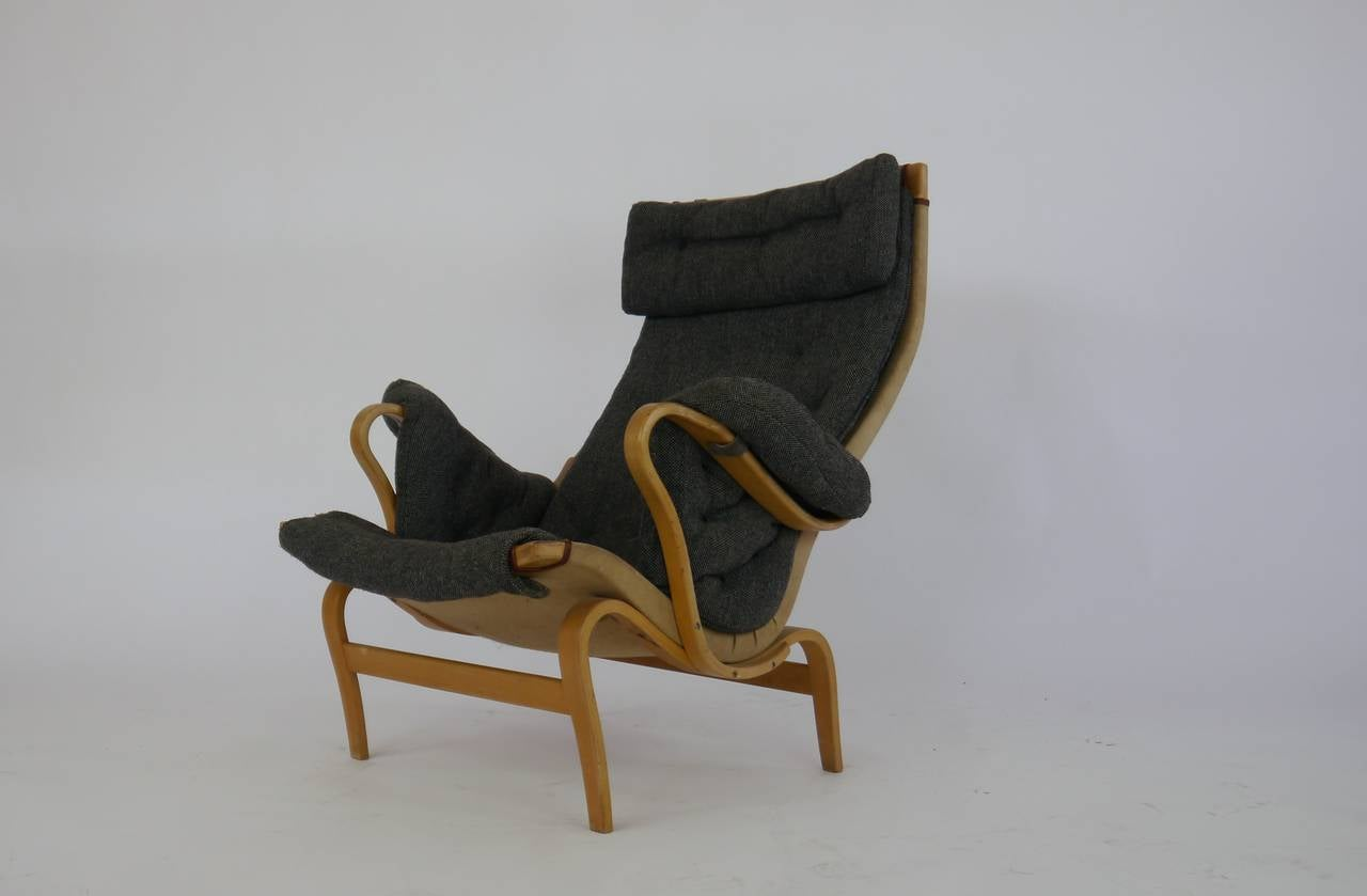 Nice 60's Pernilla lounge chair by Bruno Mathsson with original charcoal hopsack upholstery. Designed by Bruno Mathsson and Produced by Dux. One of the most comfortable lounge chairs ever produced.