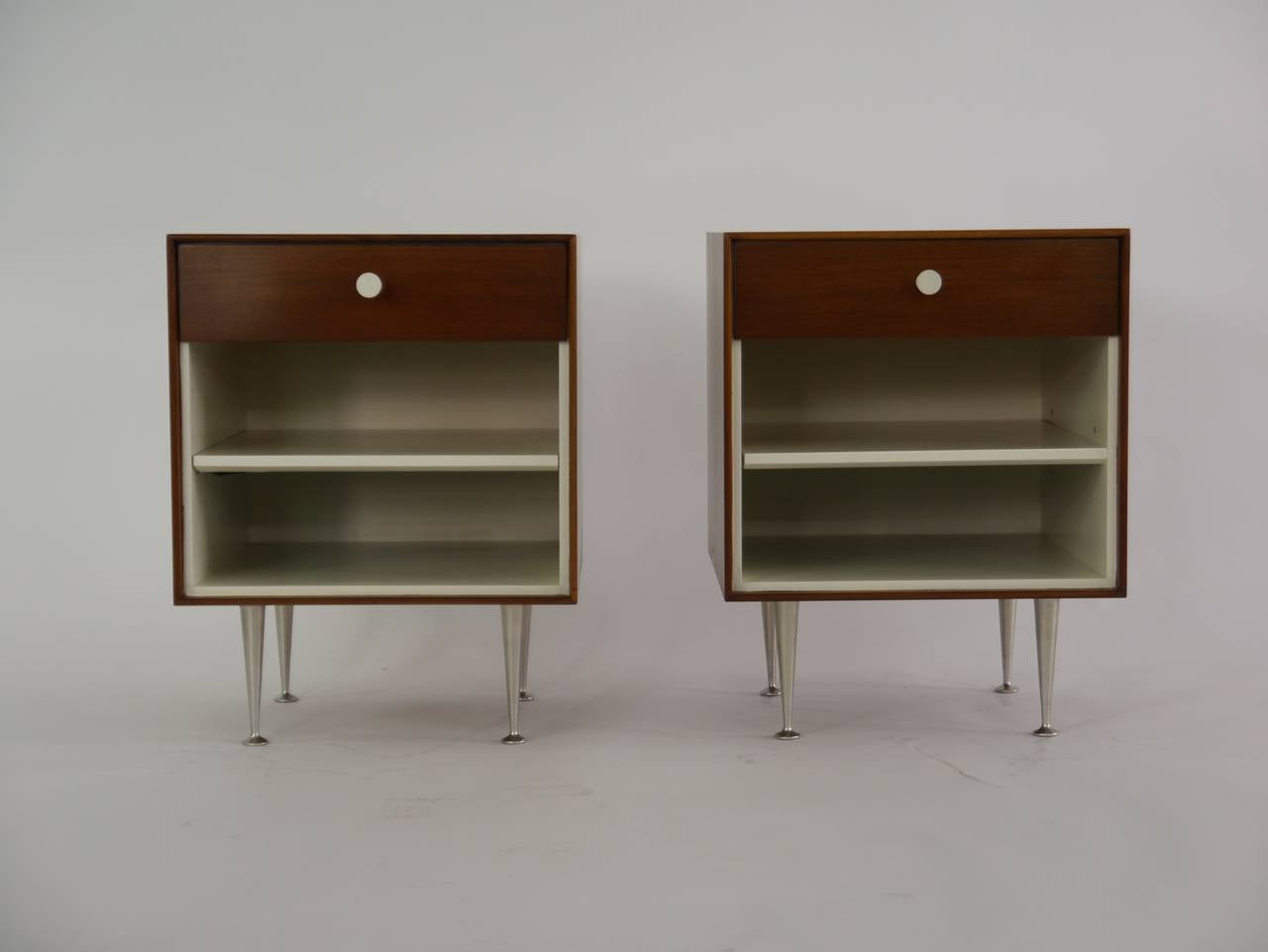 Thin Edge nightstands by George Nelson for Herman Miller. Walnut cases, lacquered interior, having one shelf, porcelain pulls and aluminum legs.