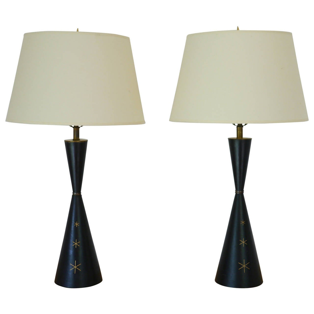 Elegant leather wrapped mid century lamps in the manner of tommi