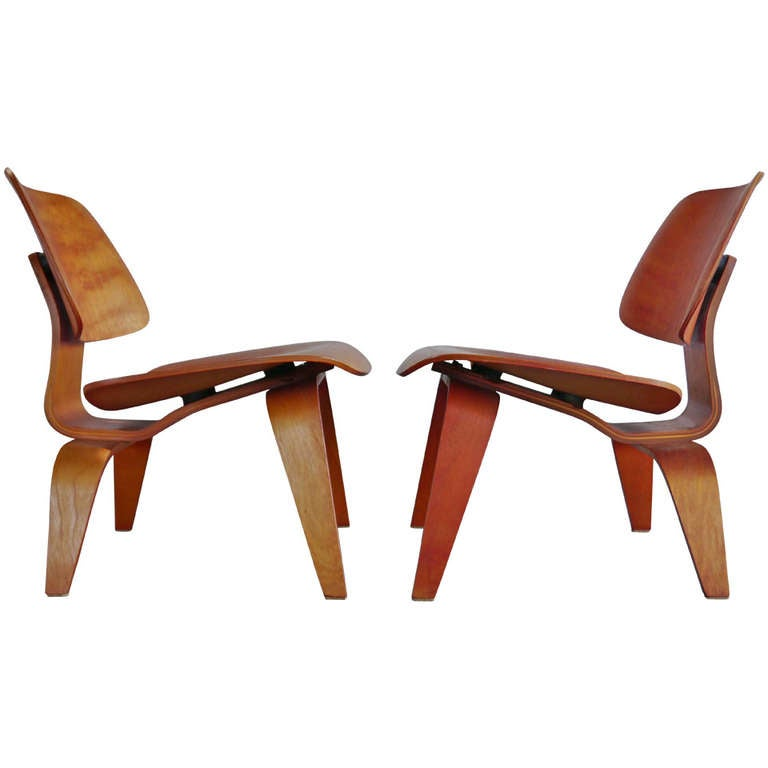 Pair of Early Red LCW Lounge Chairs by Charles Eames