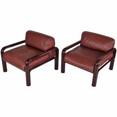 Lounge chairs in Oxblood leather by Gae Aulenti for Knoll