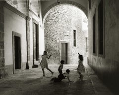 Manuel Carrillo, Untitled, Mexico. C. 1960-70s. (kids playing in archway)
